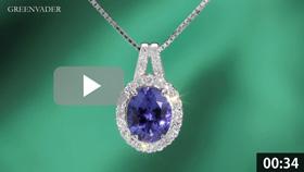 大粒タンザナイトのダイヤモンドペンダントを吊った状態で正面方向から撮影している動画です。背景はエメラルドグリーンのグラデーションで、タンザナイトの拡大したシーンでは、より詳細なデザインや宝石の美しさが見てとれます。メレダイヤモンドから美しい7色の光条が常に放たれています。